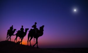 Three Wise Men following a star to Bethlehem. Rajasthan desert, India.